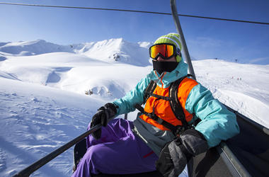 chairlift snowboarder