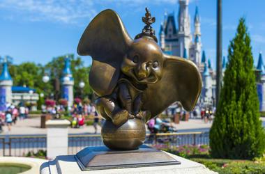 Dumbo statue at walt disney world magic kingdomorlando florida with Cinderella Princess castle