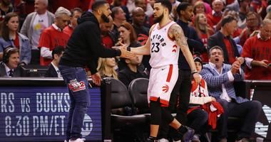 Drake high fiving the Toronto Raptors' Fred Van Vleet