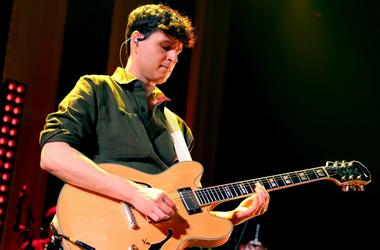 Ezra Koenig of Vampire Weekend performs on stage