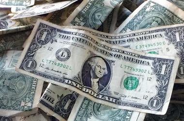FILE - This Oct. 24, 2016, file photo shows dollar bills in New York. (AP Photo/Mark Lennihan, File)