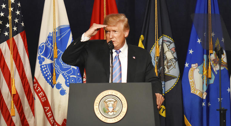 President Donald Trump looks at members of the audience during his remarks at a Salute to Service charity dinner in conjunction with the PGA Tour's Greenbrier Classic at The Greenbrier in White Sulphur Springs, W.Va. (AP Photo/Matt)