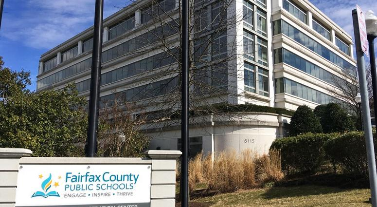 This Monday, March 4, 2019, photo shows Fairfax County Public Schools in Merrifield, Va. Virginia's largest school district is defending itself against three separate federal lawsuits filed by students. (AP Photo/Matthew Barakat)