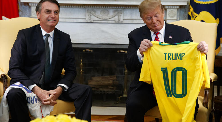 President Donald Trump speaks during a meeting with Brazilian President Jair Bolsonaro in the Oval Office of the White House, Tuesday, March 19, 2019, in Washington. (AP Photo/Evan Vucci)