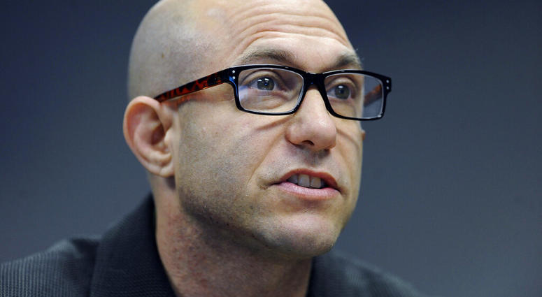 FILE - In this Nov. 14, 2014 file photo, Jeremy Richman, father of Sandy Hook Elementary school shooting victim Avielle Richman, addresses the Sandy Hook Advisory Commission in Newtown, Conn.  (AP Photo/Jessica Hill, File)