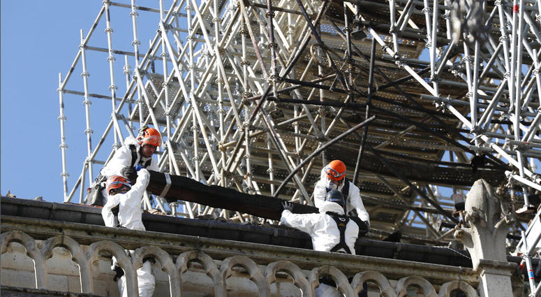 Workers install protections on Notre Dame cathedral Wednesday, April 24, 2019 in Paris.  (AP Photo/Thibault Camus)