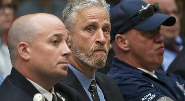 Entertainer and activist Jon Stewart lends his support to firefighters, first responders and survivors of the September 11 terror attacks at a hearing by the House Judiciary Committee.  (AP Photo/J. Scott Applewhite)
