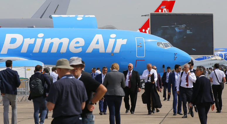 "Visitors walk past an Boeing 737-800 BCF Amazon ""Prime Air"" cargo plane at Paris Air Show, in Le Bourget, east of Paris, France, Tuesday, June 18, 2019.  (AP Photo/Michel Euler)"