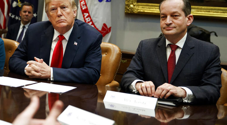FILE - In this Sept. 17, 2018, file photo, President Donald Trump, left, and Labor Secretary Alexander Acosta listen during a meeting of the President's National Council of the American Worker.  (AP Photo/Evan Vucci, File)