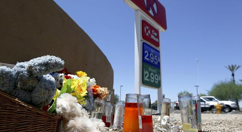 A makeshift memorial for Elijah Al-Amin is set up at a local Circle K store for the death of the stabbing victim Tuesday, July 9, 2019, in Peoria, Ariz. (AP Photo/Ross D. Franklin)