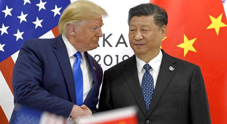 FILE - In this June 29, 2019, file photo, U.S. President Donald Trump, left, shakes hands with Chinese President Xi Jinping during a meeting on the sidelines of the G-20 summit in Osaka,