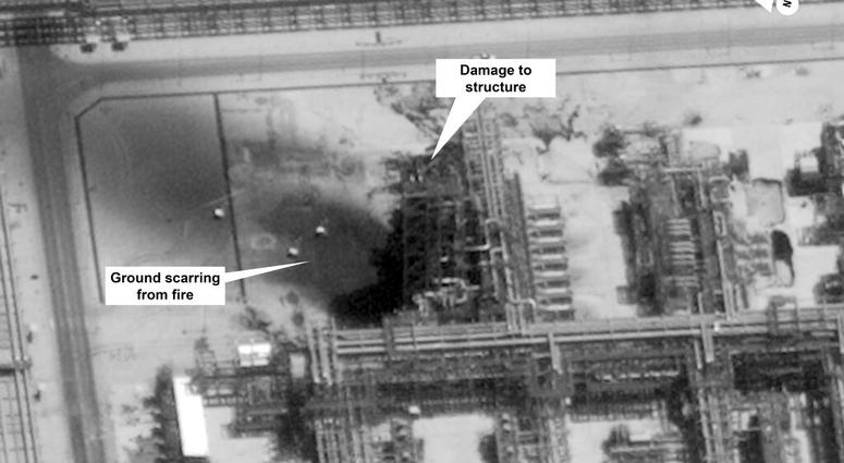 This image provided on Sunday, Sept. 15, 2019, by the U.S. government and DigitalGlobe and annotated by the source, shows damage to the infrastructure at Saudi Aramco's Kuirais oil field in Buqyaq, Saudi Arabia. (U.S. government/Digital Globe via AP)