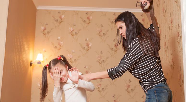 Strict mother hit her little daughter with belt.  © Nomadsoul1 - Dreamstime.com