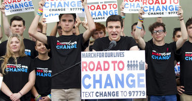 Cameron Kasky, center, speaks during a news conference, Monday, June 4, 2018, in Parkland, Fla. A day after graduating from high school.(AP Photo/Wilfredo Lee)