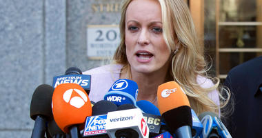 """In this April 16, 2018, file photo, adult film actress Stormy Daniels speaks outside federal court in New York. Daniels says her ex-lawyer was a """"puppet"""" for President Donald Trump.(AP Photo/Mary Altaffer, file)"""