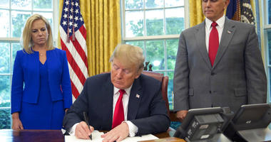 President Donald Trump signs an executive order to keep families together at the border.(AP Photo/Pablo Martinez Monsivais)