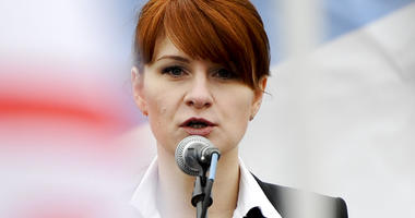 In this photo taken on Sunday, April 21, 2013, Maria Butina, leader of a pro-gun organization in Russia, speaks to a crowd during a ra in support of legalizing the possession of handguns in Moscow, Russia. (AP Photo)