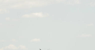 The Jefferson Memorial is visible behind Marine One, top, with President Donald Trump and first lady Melania Trump aboard, as it arrives on the South Lawn of the White House in Washington, Wednesday, July 18, 2018. (AP Photo/Andrew Harnik)