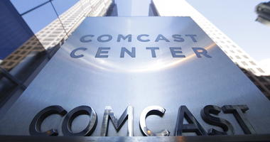 File photo shows a sign outside the Comcast Center in Philadelphia. (AP Photo/Matt Rourke, File)