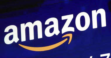 The logo for Amazon is displayed on a screen at the Nasdaq MarketSite in New York. (AP Photo/Richard Drew, File)