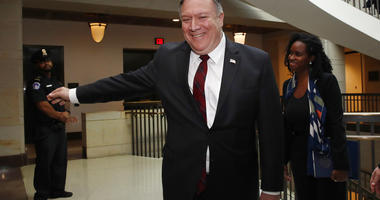 Secretary of State Mike Pompeo smiles after shaking hands with Sen. Cory Gardner, R-Colo., not shown, as Pompeo arrives for a closed door meeting with Senators about Saudi Arabia.(AP Photo/Jacquelyn Martin)