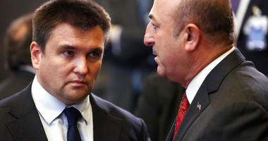 Turkish Foreign Minister Mevlut Cavusoglu, right, speaks with Ukraine's Foreign Minister Pavlo Klimkin. (AP Photo/Francisco Seco)