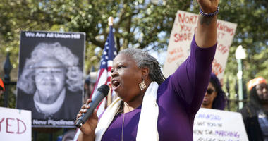 Pastor Lacette Cross, of Restoration Fellowship RVA, speaks during a protest calling for Governor Ralph Northam to resign on Monday Feb. 4, 2019. (Shelby Lum/Richmond Times-Dispatch via AP)
