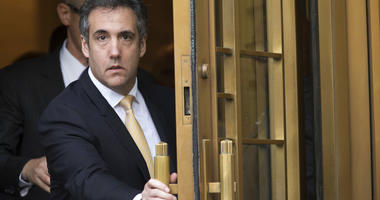 FILE - In this Aug. 21, 2018, file photo, Michael Cohen leaves Federal court, in New York. (AP Photo/Mary Altaffer, File)