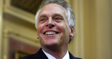 "FILE - In this Jan. 10, 2018 file photo, Virginia Gov. Terry McAuliffe delivers his final ""State of the Commonwealth"" address to the General Assembly at the Capitol in Richmond, Va.  (Bob Brown/Richmond Times-Dispatch via AP)"