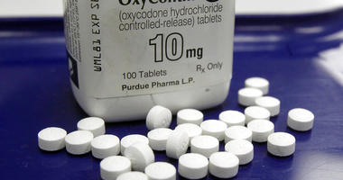FILE - This Feb. 19, 2013, file photo shows OxyContin pills arranged for a photo at a pharmacy. . (AP Photo/Toby Talbot, File)