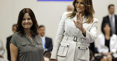 First lady Melania Trump, right, and second lady Karen Pence, left, greet students at Albritton Middle School in Fort Bragg, N.C., Monday, April 15, 2019. (AP Photo/Chuck Burton)