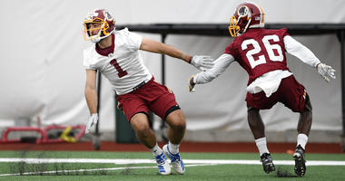 Washington Redskins wide receiver VInny Papale (1) runs a drill against cornerback Tyler Green (26) during an NFL football rookie camp, Saturday, May 11, 2019, in Ashburn, Va. (AP Photo/Nick Wass)