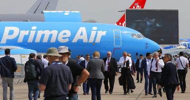 "Visitors walk past an Boeing 737-800 BCF Amazon ""Prime Air"" cargo plane at Paris Air Show, in Le Bourget, east of Paris, France, Tuesday, June 18, 2019.  (AP Photo/Michel Euler)"