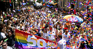 New York Governor Andrew Cuomo, lower front center, joins people participating in the LBGTQ Pride march Sunday, June 30, 2019, in New York. (AP Photo/Craig Ruttle)