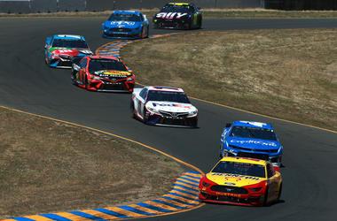 cars drag racing on track