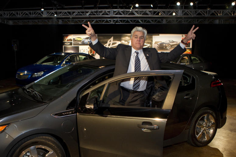 jay leno standing by car
