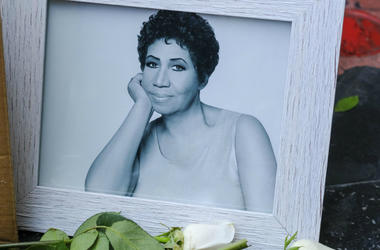 """People pay their respects with flowers and pictures on Aretha Franklin's star at the Hollywood Walk of Fame in Los Angeles.  Aretha Franklin, the """"Queen of Soul,"""" died Thursday in her home city of Detroit after battling pancreatic cancer."""