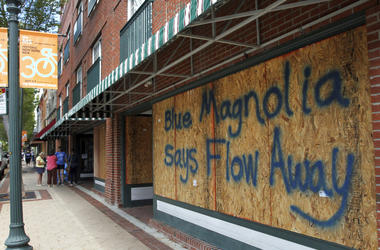 Storefronts have wood paneling installed over windows, Tuesday, Sept. 11, 2018, in New Bern, N.C., as a precaution against storm damage from Hurricane Florence.