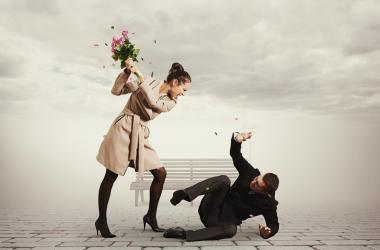Women Hitting Man With Flowers