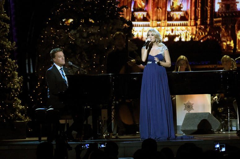 Pregnant Carrie Underwood and Michael W. Smith perform at the 2014 CMA Country Christmas concert in Nashville