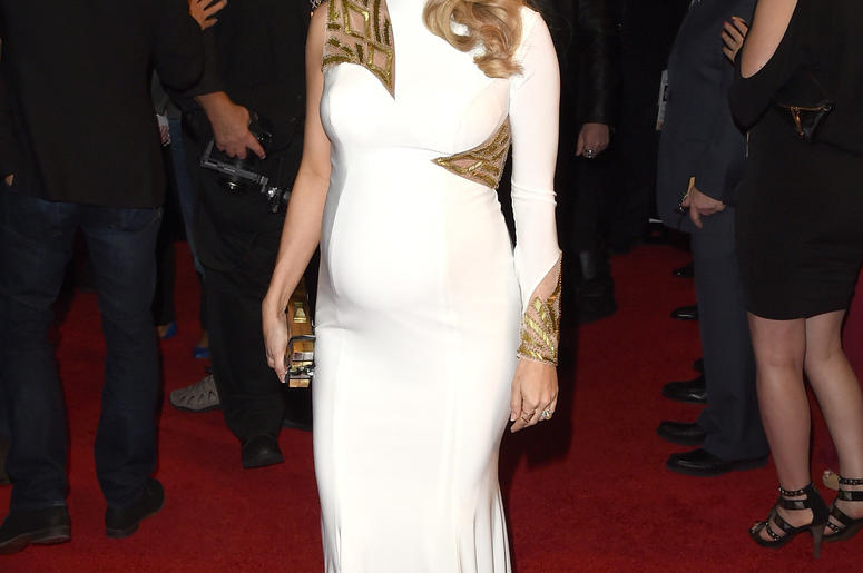 Pregnant Carrie Underwood arrives at 2014 American Country Countdown Awards in Nashville
