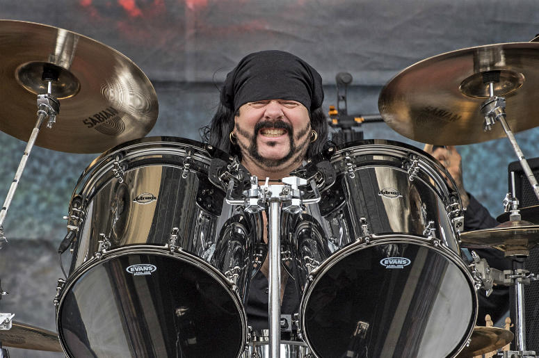 Vinnie Paul performs with Hellyeah during their set at the Rock on the Range Festival in Columbus, Ohio. This was the first time that Vinnie Paul performed in Columbus since his brother, Dimebag Darrell, was shot and killed.