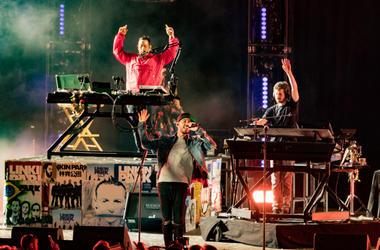 Musicians from Linkin Park; Brad Delsen, Mike Shinoda and Joe Hahn perform