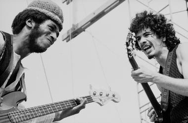 Carlos Santana (right) and David Brown perform with the other members of Santana at Woodstock
