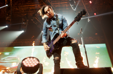 Pete Wentz of Fall Out Boy performs on stage at the Arena Birmingham