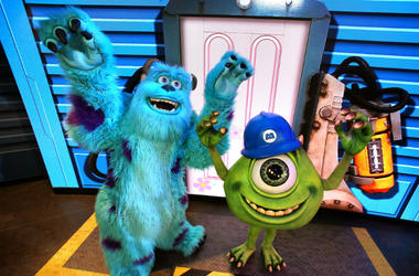 """Pixar characters Mike Wazowski, right, and Sulley greet guests at the debut of """"An Incredible Celebration"""" at Disney's Hollywood Studios"""