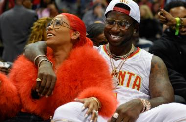 Gucci Mane reacts with Keyshia Ka'oir after being engaged during a time out during the New Orleans Pelicans and Atlanta Hawks game during the second half at Philips Arena.