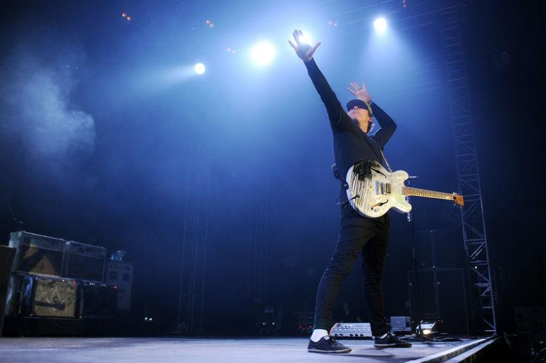 Guitarist Tom DeLonge of Blink 182 during performance in Prague, Czech republic, August 15, 2014.