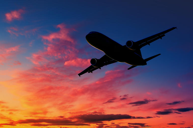 Silhouetted plane