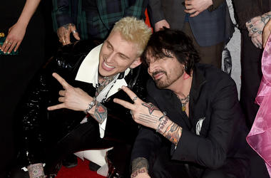Colson Baker (L) and Tommy Lee arrive at the premiere of Netflix's 'The Dirt' at ArcLight Hollywood